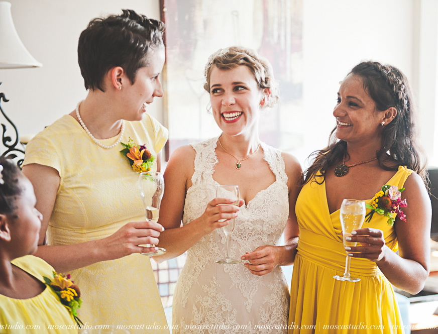 bride with bridesmaids wearing corsages