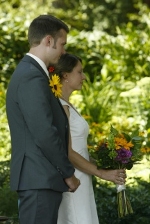 picture of man wearing a sunflower boutonniere