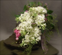 white bridal bouquet with touch of pink