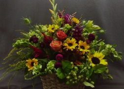 basket of boldly colored flowoers
