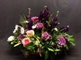 Andromeda supporting Ocean Song roses with Purple Stock, Daises and more.