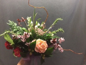 Purple Plum branches, snowflakes, Camelia all paly a role in this bespoke bouquet