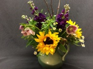 Hellebore feel at home in this sunflower and stock display