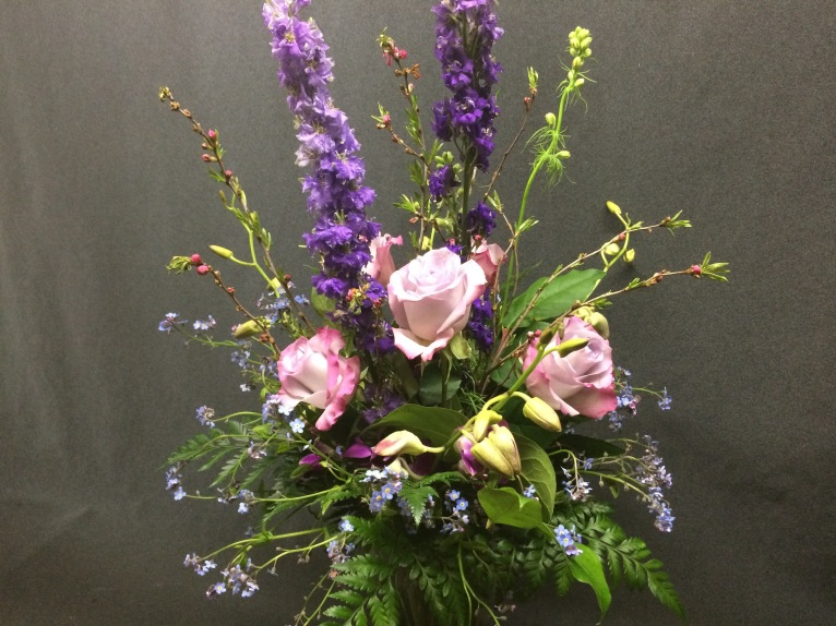 Forget Me Not lends a lacy aura to this elegant arrangment